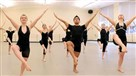 Students in advanced jazz warm up before class in Point Park University's new George Rowland White Dance Studio Two, Downtown.