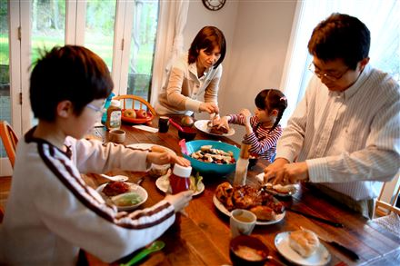 Tomoko Nukui and Tai Sing Lee have dinner with their children, Harrison and Helen, at their O'Hara home.