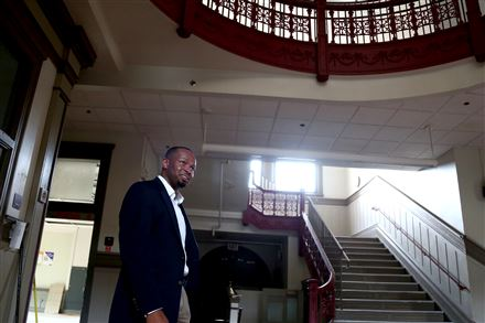 Emeka Owugbenu gives a tour of the one of his development properties in Lawrenceville, the former McCleary Elementary School.