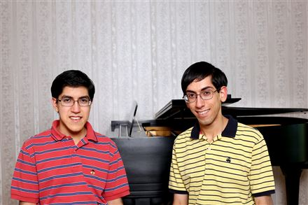 Suvir, left, 15, and brother Rishi, 17, both won awards for their research projects at the recent Intel International Science and Engineering Fair in Los Angeles.