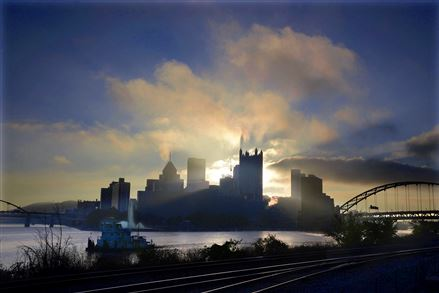 The sun rises over the Downtown Pittsburgh skyline.