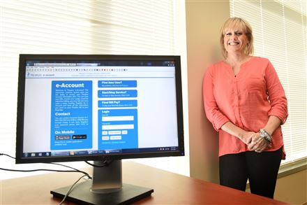 Heather Doyle-Conley is manager of the Peoples Natural Gas call center of the North Shore. The company is rolling out a system that utilizes a customer service app for smart phones.