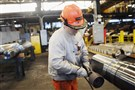 Ampco-Pittsburgh employee Mike Gamrod of Carnegie polishes rolls before they are shipped to customers.