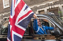 A taxi driver waves a Union Jack flag at Nigel Farage, leader of the United Kingdom's Independence Party, a day after Britain voted to break out of the European Union, in Westminster, central London, Friday.
