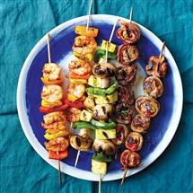 "Cajun Shrimp Skewers, vegetable skewers and Bacon-Wrapped Chicken Skewers from ""The Hungry Fan's Game Day Cookbook"" by Daina Falk."