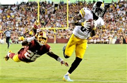 Steelers' Antonio Brown pulls in a pass for a touchdown against the Washington Redskins' Bashaud Breeland.