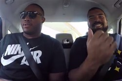 Steelers defensive linemen Stephon Tuitt, left, and Cam Heyward ride in a self-driving Uber this week.