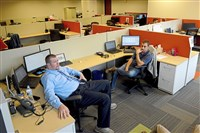Josh Hollis, left, and Kevin Gleaner of Select International in McCandless, hold a meeting at the office.
