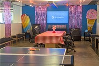 The ShowClix office lounge has ping pong and picnic tables for their employees at the front entrance.