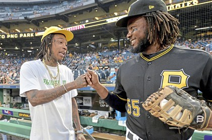 Wiz Khalifa greets Pirates Josh Bell before he throws out the first pitch Sept. 27 at PNC Park.