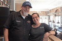 Grant Saylor and his wife, Lisa Saylor, in Lincoln Avenue Brewery, which they and another couple own.